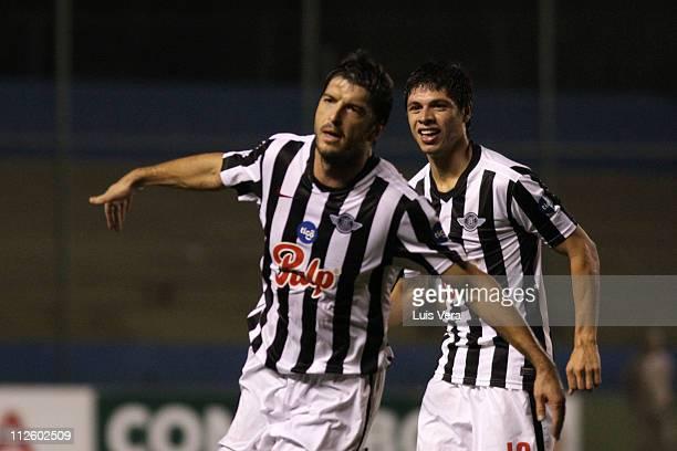Nicolas Pavlovich and Rodrigo Rojas of Libertad celebrate a scored goal against San Luis during a Santander Libertadores 2011 Cup match at Nicolas...