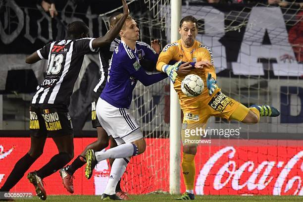 Nicolas Penneteau goalkeeper of Sporting Charleroi battles for the ball with Lukasz Teodorczyk forward of RSC Anderlecht during the Jupiler Pro...