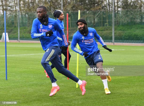 Nicolas Pepe and Alex Lacazette of Arsenal during a training session at London Colney on May 08, 2021 in St Albans, England.
