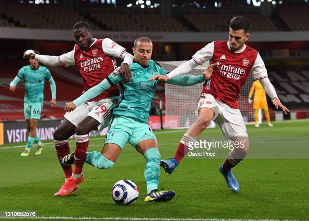 Nicolas Pepe and Dani Ceballos of Arsenal challenge Thiago of Liverpool during the Premier League match between Arsenal and Liverpool at Emirates...