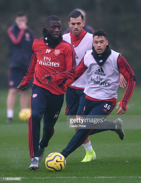 Nicolas Pepe and Gabriel Martinelli of Arsenal during the Arsenal 1st team training session at London Colney on October 26 2019 in St Albans England
