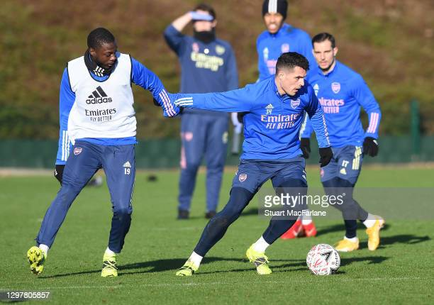 Nicolas Pepe and Granit Xhaka of Arsenal during a training session at London Colney on January 22, 2021 in St Albans, England.