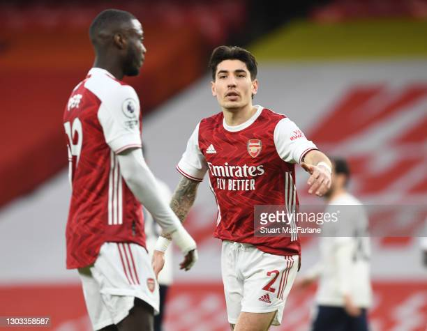 Nicolas Pepe and Hector Bellerin of Arsenal during the Premier League match between Arsenal and Manchester City at Emirates Stadium on February 21,...