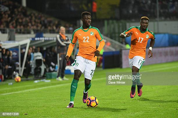 Nicolas Pepe and Serge Aurier of Ivory Coast during the International friendly match between France and Ivory Coast at Stade Bollaert-Delelis on...