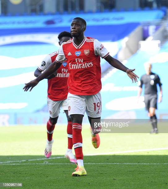 Nicolas Pepe celebrates scoring a goal for Arsenal during the Premier League match between Brighton Hove Albion and Arsenal FC at American Express...