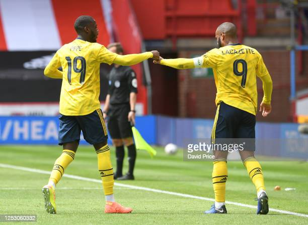 Nicolas Pepe celebrates scoring a goal for Arsenal with Alexandre Lacazette during the FA Cup Fifth Quarter Final match between Sheffield United and...