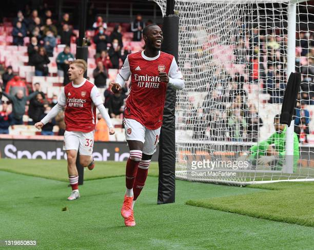 Nicolas Pepe celebrates scoring the 1st Arsenal goal during the Premier League match between Arsenal and Brighton & Hove Albion at Emirates Stadium...