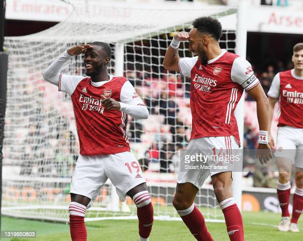 Nicolas Pepe celebrates scoring the 1st Arsenal goal with Pierre-Emerick Aubameyang during the Premier League match between Arsenal and Brighton &...