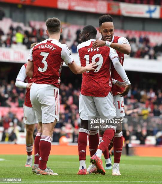 Nicolas Pepe celebrates scoring the 2nd Arsenal foal with Pierre-Emerick Aubameyang and Kieran Tierney during the Premier League match between...