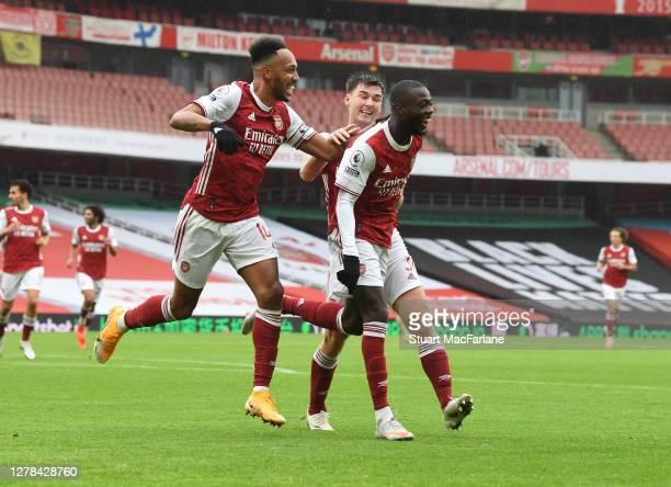 Nicolas Pepe celebrates scoring the 2nd Arsenal goal with PierreEmerick Aubameyang and Kieran Tierney during the Premier League match between Arsenal...