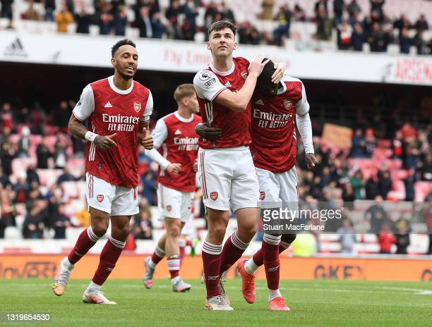 Nicolas Pepe celebrates scoring the 2nd Arsenal goal with Pierre-Emerick Aubameyang and Kieran Tierney during the Premier League match between...