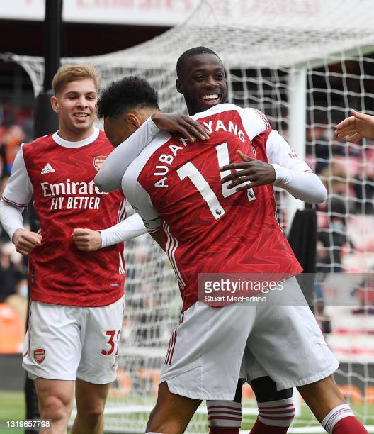 Nicolas Pepe celebrates scoring the 2nd Arsenal goal with Pierre-Emerick Aubameyang during the Premier League match between Arsenal and Brighton &...