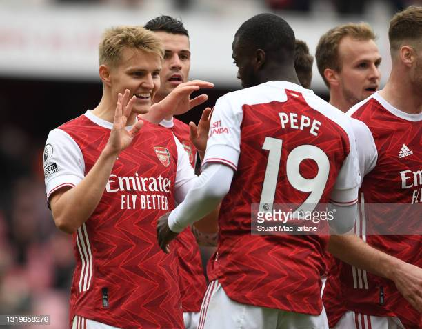 Nicolas Pepe celebrates scoring the 2nd Arsenal goal with Martin Odegaard during the Premier League match between Arsenal and Brighton & Hove Albion...
