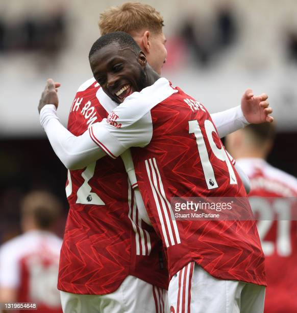 Nicolas Pepe celebrates scoring the 2nd goal with Emile Smith Rowe during the Premier League match between Arsenal and Brighton & Hove Albion at...