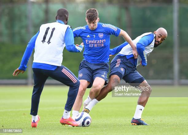 Nicolas Pepe, Kieran Tierney and Alex Lacazette of Arsenal during a training session at London Colney on May 18, 2021 in St Albans, England.