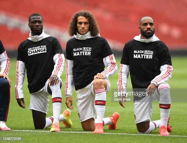 Nicolas Pepe Matteo Guendouzi and Alexandre Lacazette of Arsenal take a knee in support of Black Lives Matter before the friendly match between...