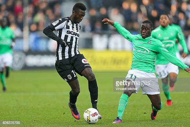 Nicolas Pepe of Angers and Henri Saivet of SaintEtienne during the French Ligue 1 match between Angers and Saint Etienne on November 27 2016 in...