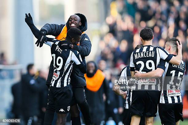 Nicolas Pepe of Angers celebrates with teammates after scoring the first goal during the French Ligue 1 match between Angers and Saint Etienne on...