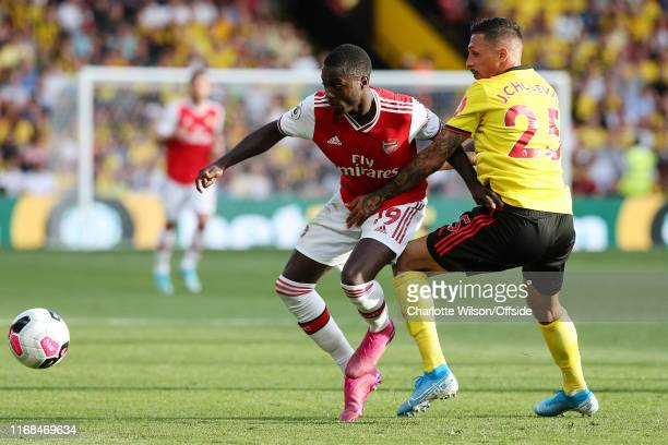 Nicolas Pepe of Arsenal and Jose Holebas of Watford during the Premier League match between Watford FC and Arsenal FC at Vicarage Road on September...