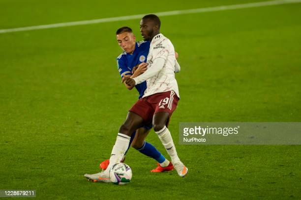 Nicolas Pepe of Arsenal and Luke Thomas of Leicester City during the Carabao Cup match between Leicester City and Arsenal at the King Power Stadium...