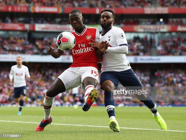 Nicolas Pepe of Arsenal battle with Danny Rose of Spurs during the Premier League match between Arsenal FC and Tottenham Hotspur at Emirates Stadium...