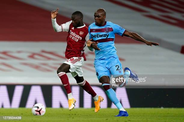Nicolas Pepe of Arsenal battles for possession with Angelo Ogbonna of West Ham United during the Premier League match between Arsenal and West Ham...