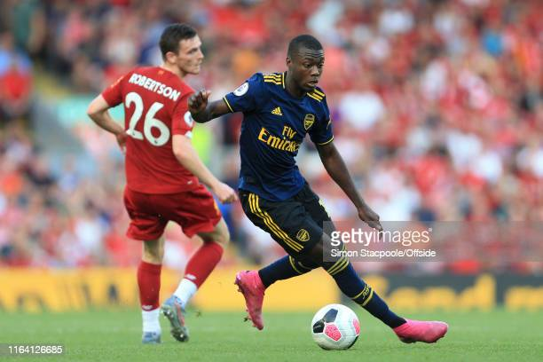 Nicolas Pepe of Arsenal battles with Andrew Robertson of Liverpool during the Premier League match between Liverpool and Arsenal at Anfield on August...