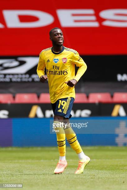 Nicolas Pepe of Arsenal celebrates after scoring his sides first goal from the penalty spot during the FA Cup Fifth Quarter Final match between...