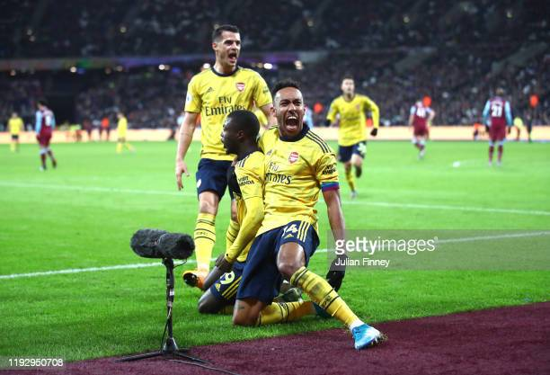 Nicolas Pepe of Arsenal celebrates after scoring his sides second goal with Pierre-Emerick Aubameyang during the Premier League match between West...