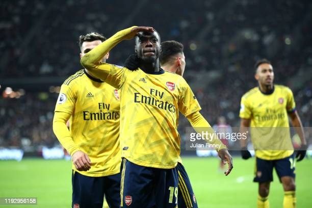 Nicolas Pepe of Arsenal celebrates after scoring his sides second goal during the Premier League match between West Ham United and Arsenal FC at...
