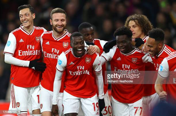Nicolas Pepe of Arsenal celebrates after scoring his sides second goal with team mates during the Premier League match between Arsenal FC and...