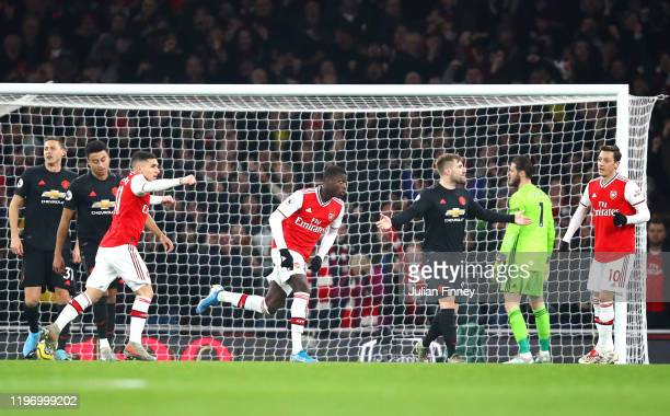 Nicolas Pepe of Arsenal celebrates after scoring his team's first goal during the Premier League match between Arsenal FC and Manchester United at...