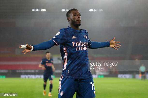 Nicolas Pepe of Arsenal celebrates after scoring his team's first goal during the Premier League match between Southampton and Arsenal at St Mary's...