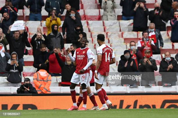 Nicolas Pepe of Arsenal celebrates after scoring their team's second goal with Pierre-Emerick Aubameyang during the Premier League match between...