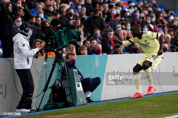 Nicolas Pepe of Arsenal celebrates in front of a TV camera after scoring his team's first goal during the Premier League match between Crystal Palace...