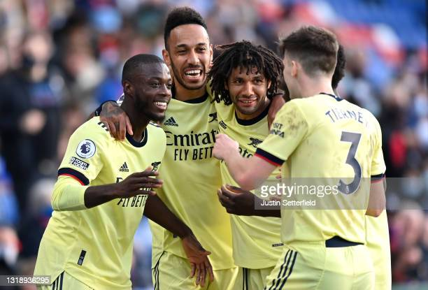 Nicolas Pepe of Arsenal celebrates scoring the 1st Arsenal goal with team mates during the Premier League match between Crystal Palace and Arsenal at...