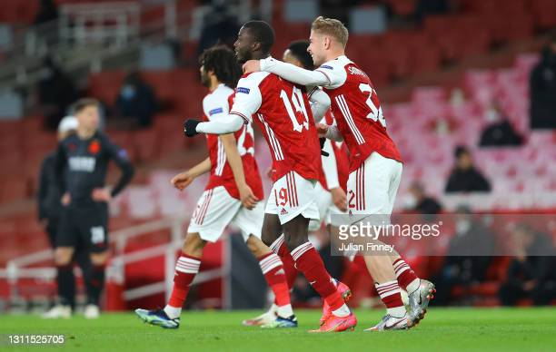 Nicolas Pepe of Arsenal celebrates with Emile Smith Rowe after scoring their side's first goal during the UEFA Europa League Quarter Final First Leg...