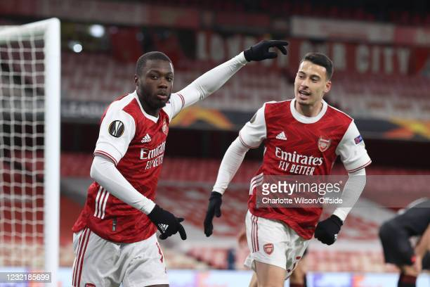 Nicolas Pepe of Arsenal celebrates with Gabriel Martinelli of Arsenal after scoring their 1st goal during the UEFA Europa League Quarter Final First...