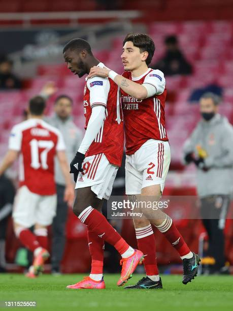 Nicolas Pepe of Arsenal celebrates with Hector Bellerin after scoring their side's first goal during the UEFA Europa League Quarter Final First Leg...