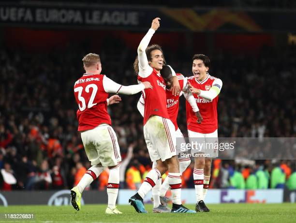 Nicolas Pepe of Arsenal celebrates with Matteo Guendouzi of Arsenal and team mates after scoring their team's third goal during the UEFA Europa...