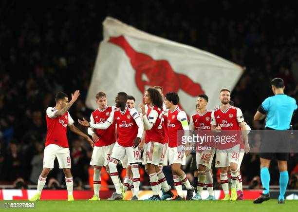 Nicolas Pepe of Arsenal celebrates with team mates after scoring his team's third goal during the UEFA Europa League group F match between Arsenal FC...