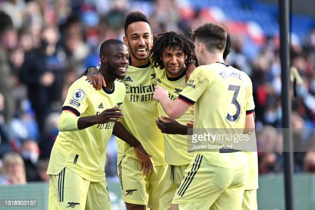 Nicolas Pepe of Arsenal celebrates with team mates Pierre Emerick Aubameyang, Mohamed Elneny and Kieran Tierney after scoring his team's first goal...