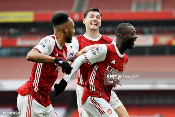 Nicolas Pepe of Arsenal celebrates with teammates after scoring his team's second goal during the Premier League match between Arsenal and Sheffield...