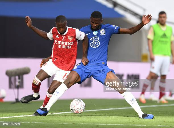 Nicolas Pepe of Arsenal challenged by Antonio Rudiger of Chelsea during the FA Cup Final match between Arsenal and Chelsea at Wembley Stadium on...