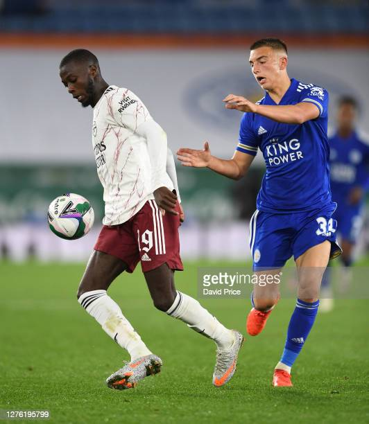 Nicolas Pepe of Arsenal controls the ball under pressure from Luke Thomas of Leicester during the Carabao Cup Third Round match between Leicester...