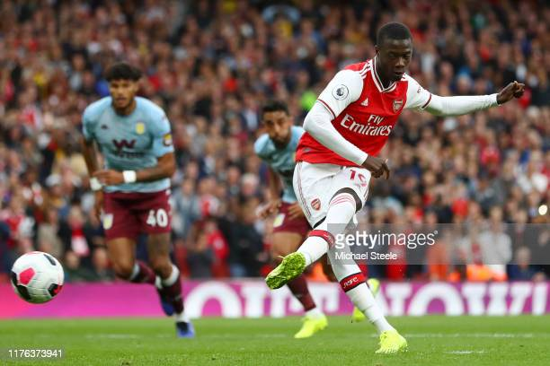 Nicolas Pepe of Arsenal converts his sides penalty and scores their first goal of the game during the Premier League match between Arsenal FC and...