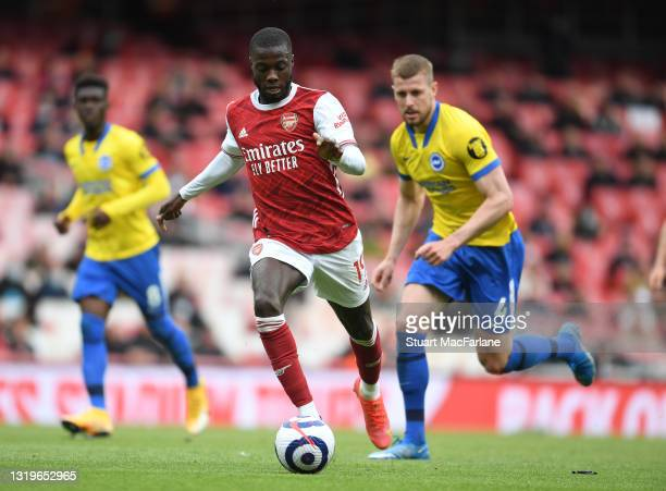 Nicolas Pepe of Arsenal during the Premier League match between Arsenal and Brighton & Hove Albion at Emirates Stadium on May 23, 2021 in London,...