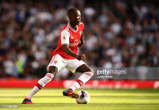 Nicolas Pepe of Arsenal in action during the Premier League match between Arsenal FC and Tottenham Hotspur at Emirates Stadium on September 01 2019...