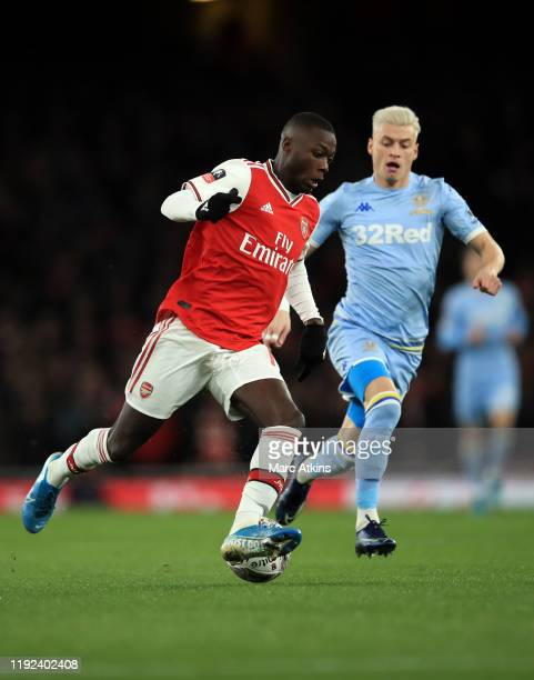 Nicolas Pepe of Arsenal in action with Ezgjan Alioski of Leeds United during the FA Cup Third Round match between Arsenal and Leeds United at...