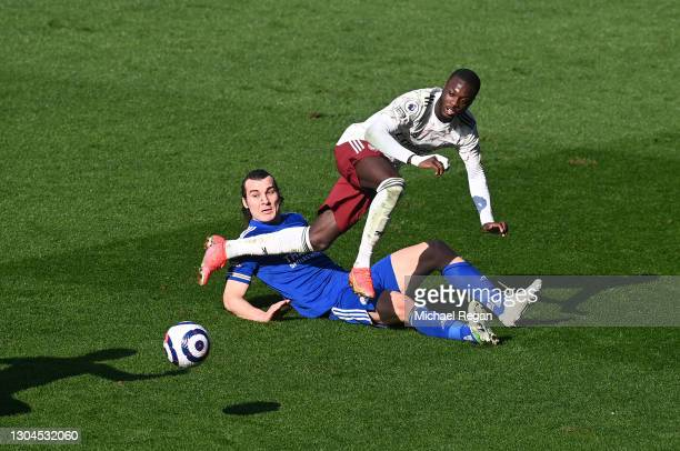 Nicolas Pepe of Arsenal is challenged by Caglar Soeyuencue of Leicester City during the Premier League match between Leicester City and Arsenal at...